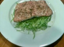 Salmon steak with snow pea salad